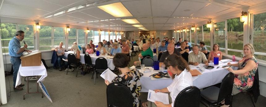 Jim Almendinger speaks to local leaders on the St. Croix River