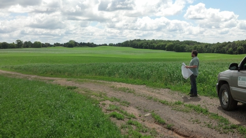 wcd employee andy schilling looks for conservation opportunities on cropland