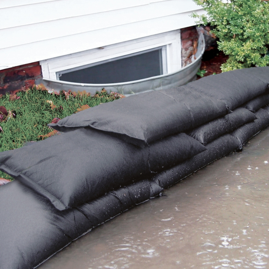 sand bags in front of a window well